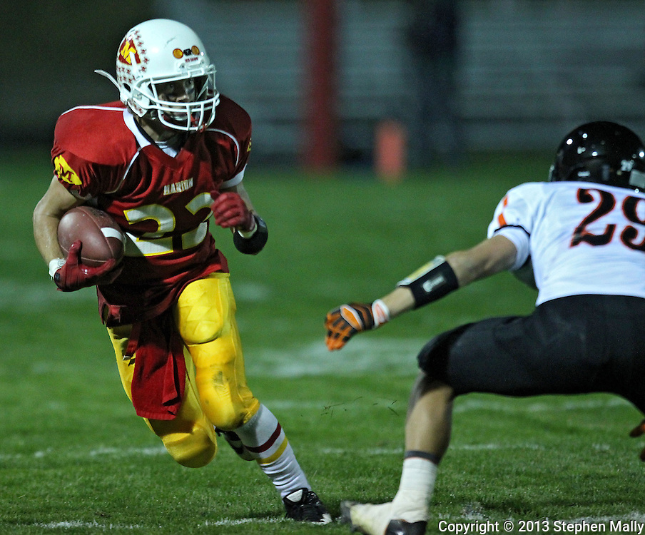 Marion's Logan Fuller (23) tries to avoid Washington's Jacob Hennigan (29) as he carries the ball during their game at Thomas Park Field in Marion on Friday, September 20, 2013.