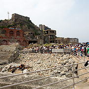 "NAGASAKI, JAPAN - AUGUST 8: Tourists visits Hashima Island, commonly known as Gunkanjima or ""Battleship Island"" in Nagasaki Prefecture, southern Japan on August 8, 2017. The island was a coal mining facility until its closure in 1974 is a symbol of the rapid industrialization of Japan, a reminder of its dark history as a site of forced labor during the Second World War. The island now is recognized as UNESCO's World Heritage sites of Japan's Meiji Industrial Revolution. (Photo: Richard Atrero de Guzman/NURPhoto)"