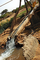 Niger, Agadez, Tidene, 2007. Water cascades first into a sluice, then is chanelled into an irrigation system that feeds many acres of Tuareg gardens.