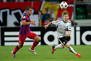 (R) Legia's Jakub Kosecki fights for the ball during the UEFA Champions League play-off second leg match between Legia Warsaw and FC Steaua Bucuresti at Pepsi Arena Stadium in Warsaw on August 27, 2013.<br /> <br /> Poland, Warsaw, August 27, 2013<br /> <br /> Picture also available in RAW (NEF) or TIFF format on special request.<br /> <br /> For editorial use only. Any commercial or promotional use requires permission.<br /> <br /> Photo by &copy; Adam Nurkiewicz / Mediasport