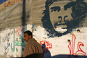Che Guevara has been painted on the Wall. It is common image along the wall separating; Palestine and Israel.