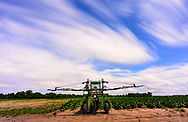 Long Exposure rural landscape in Pitt County, sprayer, tobacco and clouds