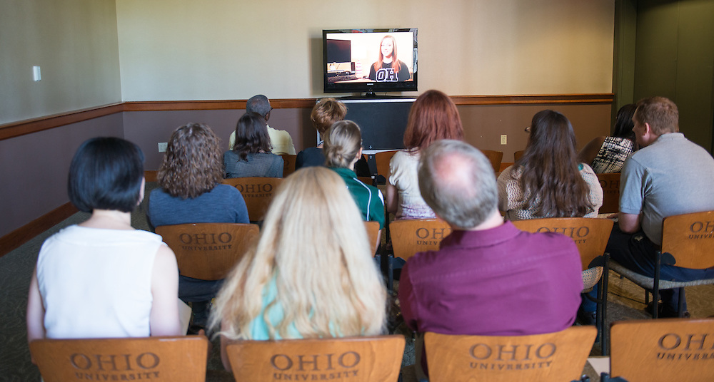 Faculty and staff view new commercials that accompany the Your Passport to the OHIO Guarantee initiative. Photo by Ben Siegel