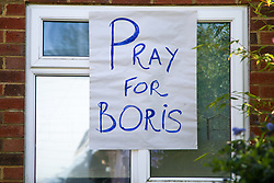 © Licensed to London News Pictures. 07/04/2020. London, UK. 'PRAY FOR BORIS' sign displayed in a window of a residential property in north London. British Prime Minster Boris Johnson was admitted to the intensive care unit at St Thomas' Hospital in central London on Monday 6 April, after his conditioned worsened of COVID-19. Photo credit: Dinendra Haria/LNP