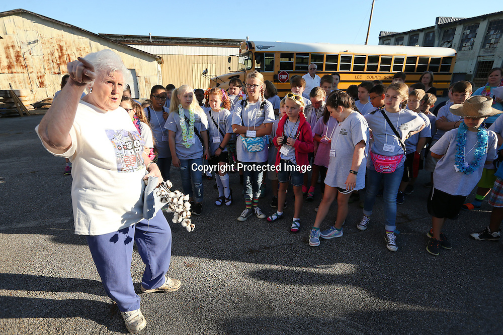 Adam Robison | BUY AT PHOTOS.DJOURNAL.COM<br /> Kay Bramlett, of Tupelo, and a life long resident of the Mill Village neighborhood, gives a history lesson about the Mill Village area to fifth graders from Mooreville Elementary School, as they take a tour of Tupelo that started at the JJ Rogers Building Friday morning.