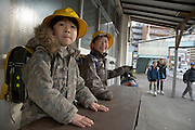 Japanese school children playing while on there way to school