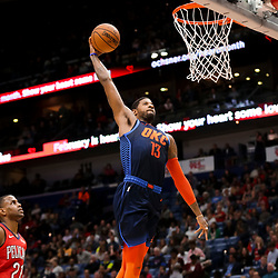 Feb 14, 2019; New Orleans, LA, USA; Oklahoma City Thunder forward Paul George (13) dunks over New Orleans Pelicans forward Darius Miller (21) during the second quarter at the Smoothie King Center. Mandatory Credit: Derick E. Hingle-USA TODAY Sports