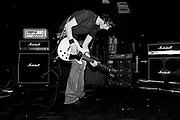 A man in an indie band, playing guitar on stage, The Very Aberdeen festival, Aberdeen, Scotland, 2005