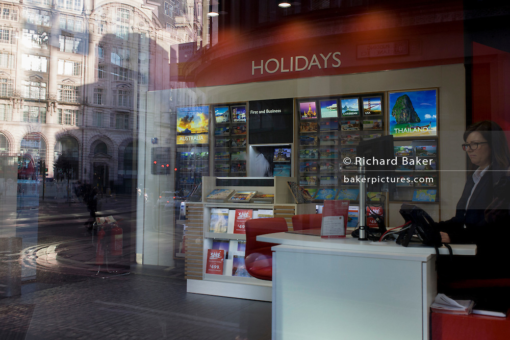 Travel agency employee and shop display with City of London background.