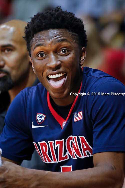 SHOT 2/26/15 9:55:06 PM - Arizona's Stanley Johnson #5 reacts to the taunts of Colorado basketball fans from the bench during their regular season Pac-12 basketball game at the Coors Events Center in Boulder, Co. Arizona won the game 82-54.<br /> (Photo by Marc Piscotty / &copy; 2015)