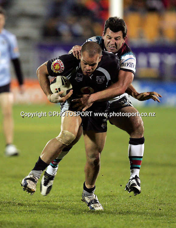 Warriors' Sam Rapira is tackled by Penrith Captain Craig Gower during the NRL rugby league match between the Vodafone Warriors and the Penrith Panthers at Mt Smart Stadium, Auckland on Friday 22 June 2007. Photo: Hagen Hopkins/PHOTOSPORT **NO COMMERCIAL USE**