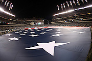 Fireworks go off as members of the United States Army hold a large American flag on the field during pregame celebrations before the Philadelphia Eagles NFL NFC Wild Card football game against the New Orleans Saints on Saturday, Jan. 4, 2014 in Philadelphia. The Saints won the game 26-24. ©Paul Anthony Spinelli