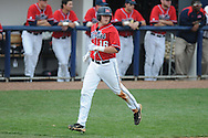Ole Miss' Matt Smith (16) scores on a Ole Miss' Matt Tracy (29) double vs. Lipscomb at Oxford-University Stadium in Oxford, Miss. on Sunday, March 13, 2011. Ole Miss won 5-1 to sweep the series and improve to 13-4.