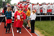 Salutatorian Skylar Duckworth exits the stage during the Northridge High School 79th annual commencement at the Northridge High School Stadium in Dayton, Friday, June 1, 2012.