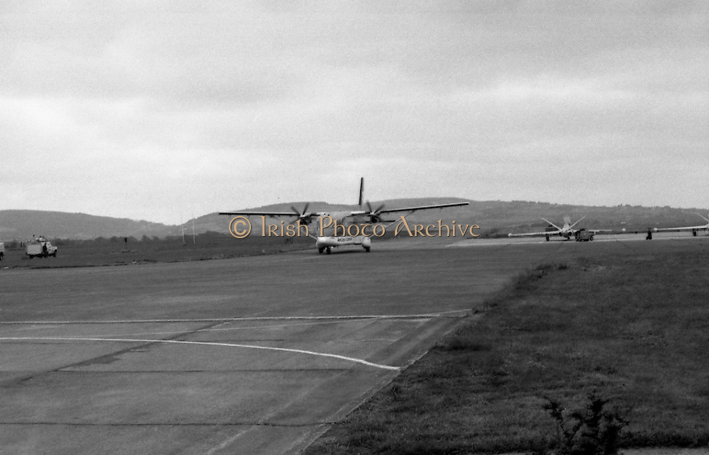 """Wrongway Corrigan"" at Baldonnell.  (R84)..1988..18.07.1988..07.18.1988..18th July 1988..Douglas ""Wrongway"" Corrigan returned to Baldonnell Airdrome 50 years after his transatlantic flight in a Curtiss Robin aircraft. After a transcontinental flight from California to New York, Mr Corrigan was to make a return flight to California. However on take off he took off over the Atlantic to Ireland. He had been refused permission from American authorities to fly solo to Ireland. On Arrival in Ireland he maintained that bad weather conditions and compass malfunction were the reason for his ""wrongway' flight..In 1938 he was met by Mr R W O'Sullivan as he disembarked from his plane..Comdt D K Johnston, Irish Air Corps flew in formation with Mr Corrigan in Irish Airspace..Mr J Maher,Aer Lingus Chief Engineer,hangared the aircraft on arrival and Mr V Ellis of Oriole Steamship Lines was responsible for the transportation of the aircraft back to the U.S. aboard the S S Lehigh.  These gentlemen were here today to meet again with Mr Corrigan... Image shows the plane carrying Mr Corrigan arriving at Baldonnell Aerodrome."