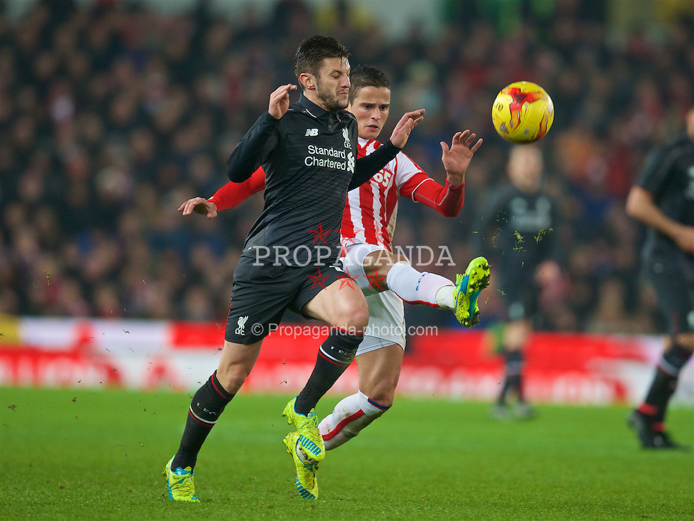 STOKE-ON-TRENT, ENGLAND - Tuesday, January 5, 2016: Liverpool's Adam Lallana in action against Stoke City during the Football League Cup Semi-Final 1st Leg match at the Britannia Stadium. (Pic by David Rawcliffe/Propaganda)