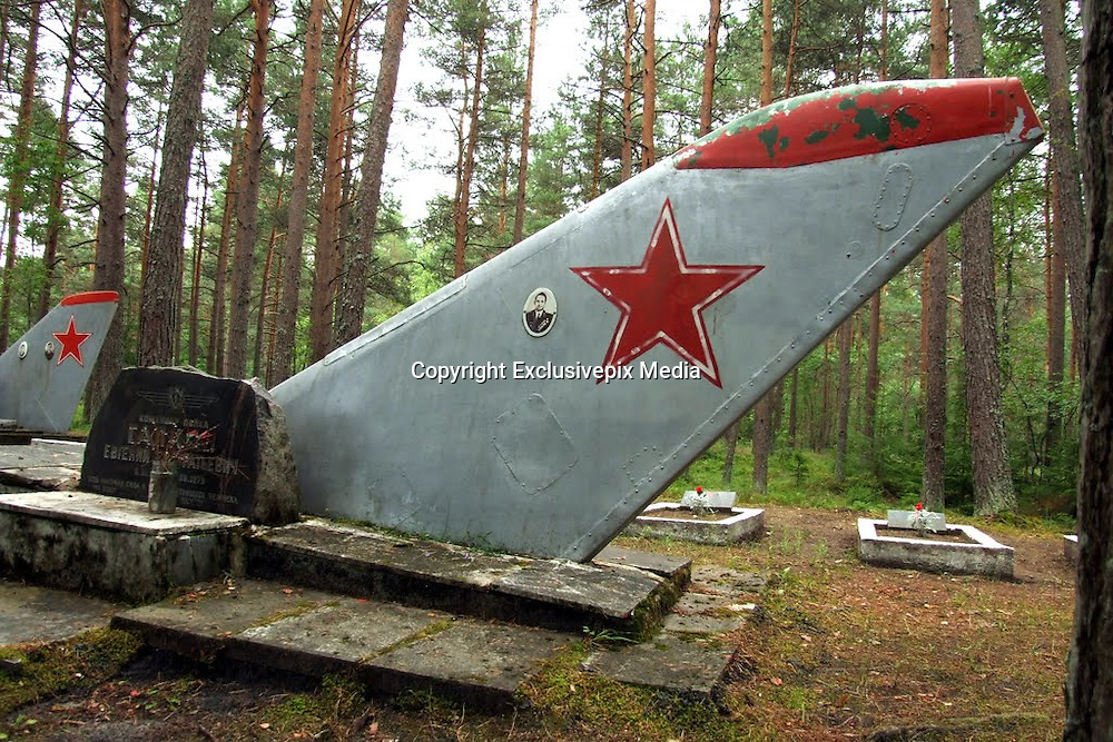 Ämari Pilots' Cemetery: The Woodland Graves of Deceased Soviet Flyers<br /> <br /> In September 2010 the 9,000-foot runway at Ämari Air Base in Estonia was relaid in a bid to transition the former Warsaw Pact airfield to NATO use. But echoes of its Soviet days abound across the site, nowhere more poignant than the unusual Ämari pilots' cemetery, which lies in woodland south of the airfield.<br /> Originally called Suurküla, Ämari Air Base lies in Estonia's Harju County, four miles south of Lake Klooga. Before the collapse of the Soviet Union it was home to several squadrons of Sukhoi Su-24 Fencer medium bombers.<br /> But since April 2014, the facility has hosted a detachment of Danish F-16 fighter jets, tasked with NATO's mission to defend the airspace of Estonia, Latvia and Lithuania.<br /> Meanwhile, in the base's woodland cemetery rest the bodies of Soviet pilots killed on active service, some of their graves marked by the tail fins of Russian-built combat aircraft against which, ironically, the base is defended today.<br /> ©Modris Putns/Exclusivepix Media