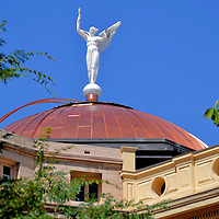 Arizona State Capitol Building in Phoenix, Arizona<br /> The Arizona State Capitol in Phoenix opened in 1901 and became a museum in 1977.  At the peak of its copper dome is an adornment resembling the Greek goddess Nike from the headless statue called the Winged Victory of Samothrace from the second century B.C.  The legislative branches are located in adjacent buildings.  Arizona became the 48th state on February 14, 1912.