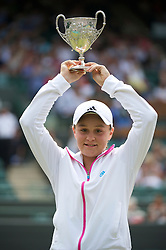 LONDON, ENGLAND - Sunday, July 3, 2011: Ashleigh Barty (AUS) celebrates with the trophy after winning the Girls' Singles Final match on day thirteen of the Wimbledon Lawn Tennis Championships at the All England Lawn Tennis and Croquet Club. (Pic by David Rawcliffe/Propaganda)