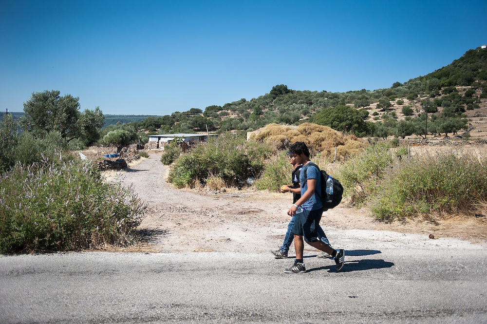 Hassan and Hussein from Syria walk towards Mytiline. Refugees land at the northern shores of the island of Lesbos and then they have to walk the 9 hour distance to one of the camps.