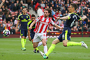 Arsenal defender Laurent Koscielny and Stoke City midfielder Joe Allen challenge for the ball during the Premier League match between Stoke City and Arsenal at the Bet365 Stadium, Stoke-on-Trent, England on 13 May 2017. Photo by Aaron  Lupton.