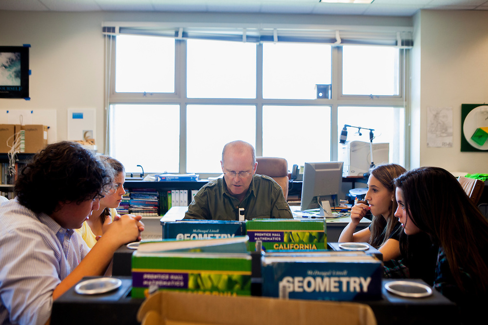 John Rich works with students in his class at Thurgood Marshall Middle School. May of the supplies at the school are purchased by the teachers themselves or by the PTSA, due to a small supply budget.