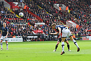 Millwall FC defender Shaun Hutchinson (4) heads towards goal during the EFL Sky Bet Championship match between Sheffield United and Millwall at Bramall Lane, Sheffield, England on 14 April 2018. Picture by Ian Lyall.