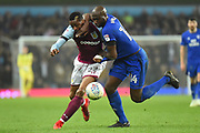 Cardiff City defender Sol Bamba (14) battles for possession  with Aston Villa striker Jonathan Kodjia (22) during the EFL Sky Bet Championship match between Aston Villa and Cardiff City at Villa Park, Birmingham, England on 10 April 2018. Picture by Dennis Goodwin.