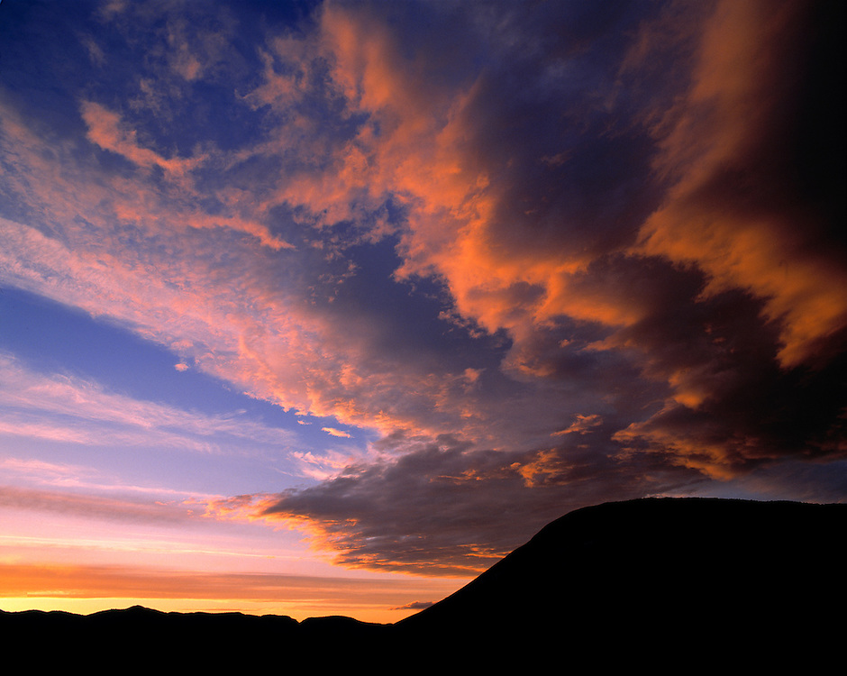 Sunset falls dramatically over the Painted Hills, in Oregon's John Day Fossil Beds National Monument. ©Ric Ergenbright