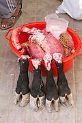 Uzbekistan, Khiva, Dekhon Bazaar.<br /> Cow feet, lungs and heart.
