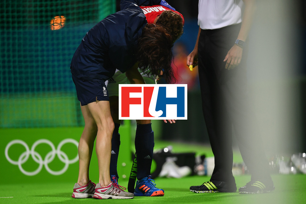 Britain's Harry Martin is injured during the mens's field hockey Britain vs Spain match of the Rio 2016 Olympics Games at the Olympic Hockey Centre in Rio de Janeiro on August, 12 2016. / AFP / MANAN VATSYAYANA        (Photo credit should read MANAN VATSYAYANA/AFP/Getty Images)