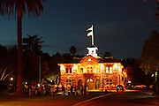 Early evening photograph of the courthouse in the square in Sonoma, CA. A group of anti-war protesters (Iraq) holds a vigil. 2004.