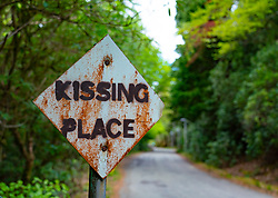 Sign at passing place changed to Kissing Place in Glen Coe , Scotland