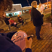 People write messages on balloons during a candlelight vigil in memory of Zoe Post in Troy, Ala., Monday, Dec. 15, 2014. Family, friends and community members gathered to honor the memory of Post on her birthday. Post died two years ago. David Post, Zoe's father, said they were 'remembering her life' and raising awareness of the effects of bullying. (Photo/Thomas Graning)