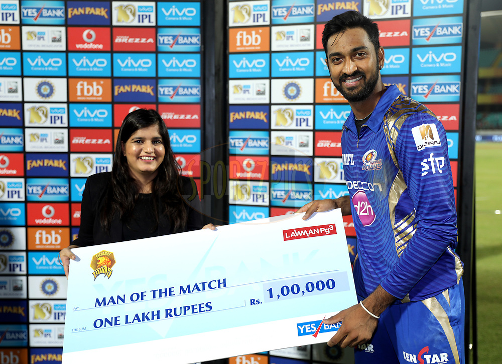 Krunal Pandya of the Mumbai Indians receives the man of the match award during the presentation of the match 35 of the Vivo 2017 Indian Premier League between the Gujarat Lions and the Mumbai Indians  held at the Saurashtra Cricket Association Stadium in Rajkot, India on the 29th April 2017<br /> <br /> Photo by Sandeep Shetty - Sportzpics - IPL