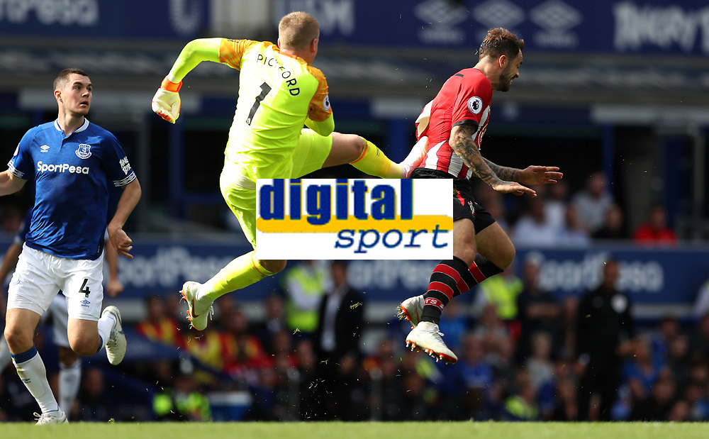 Football - 2018 / 2019 Premier League - Everton vs. Southampton<br /> <br /> Jordan Pickford of Everton challenges Danny Ings of Southampton ripping his shirt and leaving stud marks on his back at Goodison Park.<br /> <br /> COLORSPORT/LYNNE CAMERON