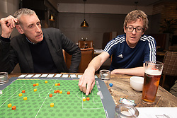 Edinburgh football fan and game designer Colin Webster has designed a brand-new football strategy game called Counter Attack. Last night he hosted a game session in Leith to demonstrate the game to a few interested players. The game is currently on the crowd-funding site Kickstarter and on track to meet it's funding target. If so, Colin hopes the gamne will be available by August this year. Pictured: Colin explaining the nicieties of a shot on goal<br /> <br /> <br /> &copy; Jon Davey/ EEm