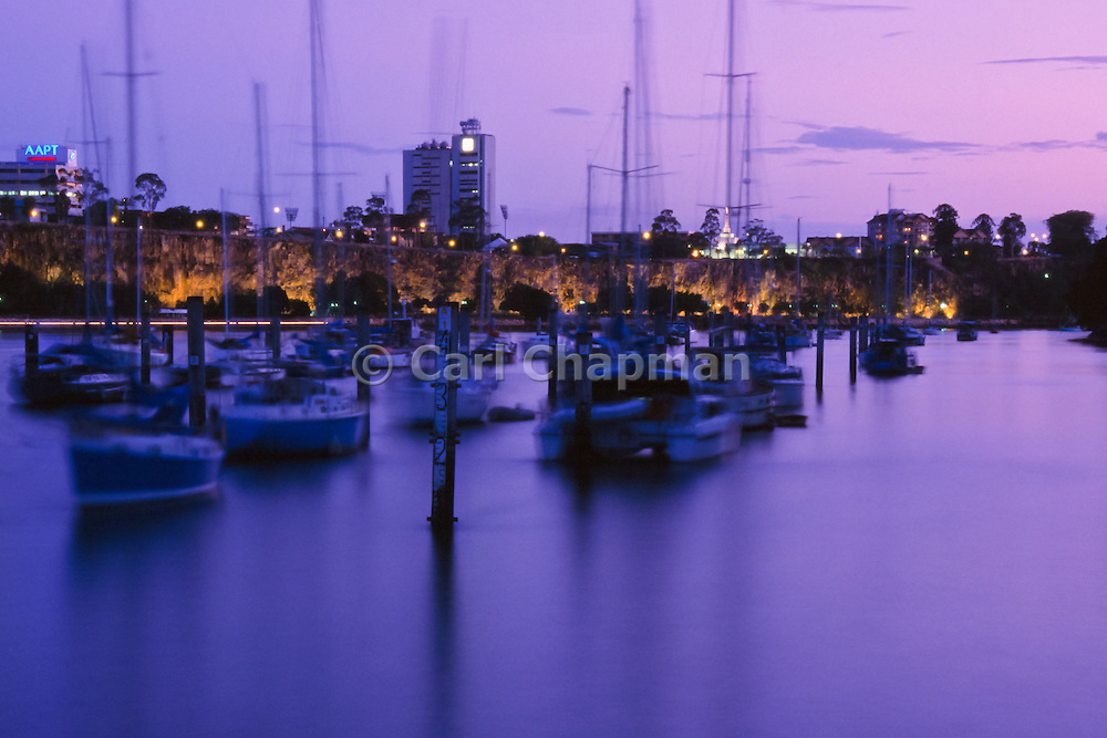 Boats moored on the Brisbane river at Sunset