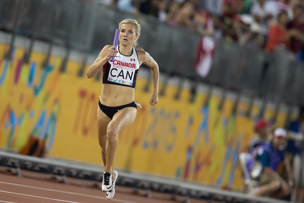 Brianne Theisen-Eaton of Canada competes in the women's 4x400 metre relay at the 2015 Pan American Games at CIBC Athletics Stadium in Toronto, Canada, July 25,  2015.  AFP PHOTO/GEOFF ROBINS