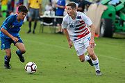 Team USA forward Federico Oliva (18)  dribbles the ball against midfielder Emilio Korich (15) during a CONCACAF boys under-15 championship soccer game, Monday, Aug. 5, 2019, in Bradenton, Fla. The USA defeated Guatemala  2-0 (Kim Hukari/Image of Sport)
