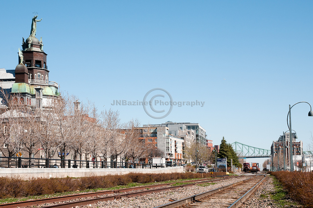 Train tracks run along the St-Lawrence river and through the Old Port of Montreal.(Quebec, Canada)