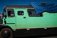 An old Argentinian bus which had transported 12 men to Rio and was now parked at the site set up for football fans who had nowhere to stay but the tents, campervans, cars and caravans that they had bought with them. The site, at the Terreirao Do Samba, Rio de Janeiro, Brazil, was arranged by the city government once they realised the number of fans in this situation was significant and rather than having them scattered about the sity they offered secure, enclosed accommodation with sanitation and water. The majority of fans at the site were Argentinian but there were also people from Chile, USA, Uruguay and Colombia. Photo by Andrew Tobin/Tobinators Ltd