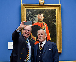 Pictured: Chair of the Board of Trustees at the Royal Scots Dragoon Guards Museum Brigadier Mel Jameson (right) and current Colonel Brigadier David Allfrey (left) take a selfie to mark the moment as the portrait going on display.<br /> <br /> The Scottish National Gallery has unveiled details of a loan deal that will see Valentin Serov's rare portrait of Tsar Nicholas II go on display. The painting is owned by the Royal Scots Dragoon Guards Regimental Trust.<br /> <br /> © Dave Johnston / EEm