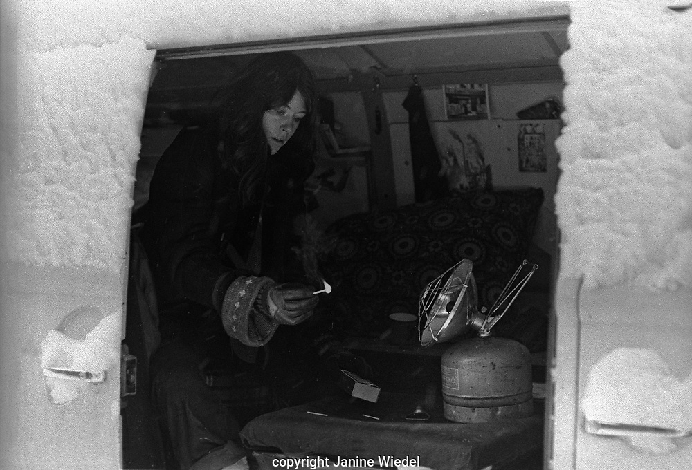 Janine Wiedel keeping warm in her Volkswagon mobile darkroom and home while photographing Vulcan's Forge a study of industriesin the West Midlands in 1970s