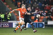Blackpool's Brad Potts (8) and Barnsley's Adam Hammill (7)  during the The FA Cup 3rd round match between Blackpool and Barnsley at Bloomfield Road, Blackpool, England on 7 January 2017. Photo by Craig Galloway.