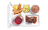 Petit Filet Mignon au poirve, frites with mustard aoili, frisee salad with lardons, chocolate mousse, red wine. Photograph by Jonathan Gayman, food styling by Carrie Province.