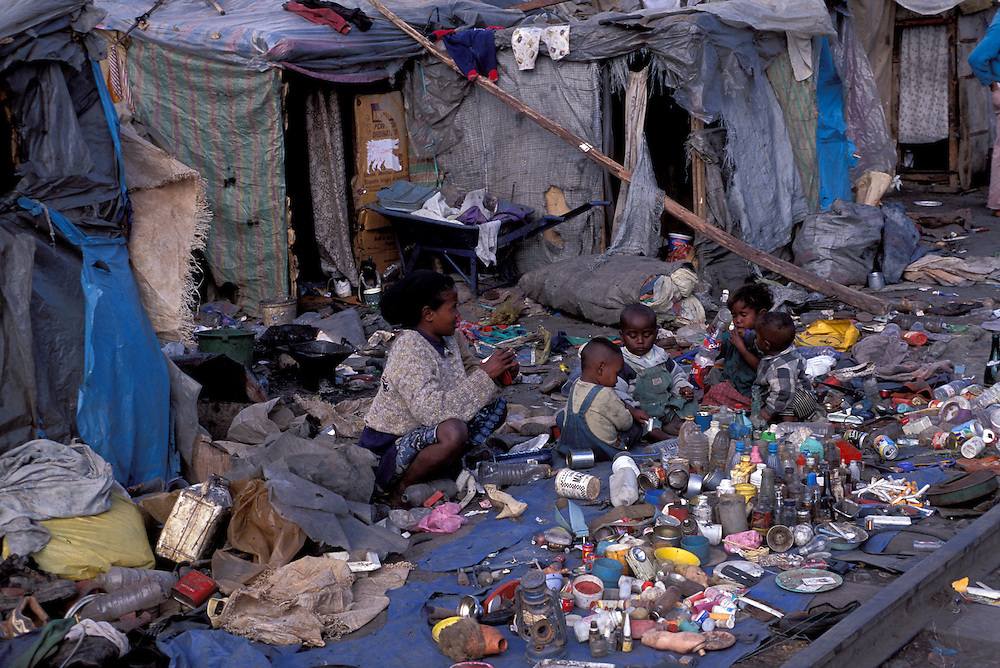 Family living on a rubbish sorting area beside the railway tracks, Antananarivo