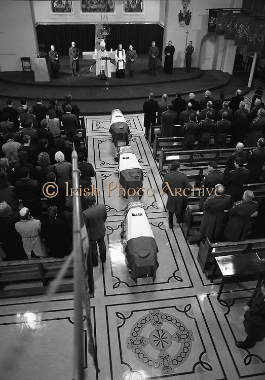 Irish Soldiers Bodies Returned From Lebanon. (R99)..1989..24.03.1989..03.24.1989..24th March 1989..While serving on the peacekeeping mission with the UN three Irish soldiers lost their lives when the vehicle they were in struck a land mine. The mine had ben planted by a Hezbollah Group who were targeting the Israeli military. The Soldiers; Corp Fintan Heneghan, Pte Mannix Armstrong and Pte Thomas Walshe were serving with C Company, 64th Infantry Batallion in Brashit, Sth Lebanon...Image shows the interior of Arbour Hill Church with the coffins of Corp Fintan Heneghan, Pte Mannix Armstrong and Pte Thomas Walshe lying in state.