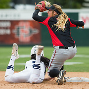 12 May 2018: San Diego State second baseman Katie Byrd (11) tags out Utah State's Jazmin Clarke (2) after getting caught attempting to turn a double into a triple. San Diego State women's softball closed out the season against Utah State with a 4-3 win on seniors day and sweep the series. <br /> More game action at sdsuaztecphotos.com