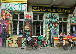 Graffiti covered old apartment building in Friedrichshain district of Berlin Germany